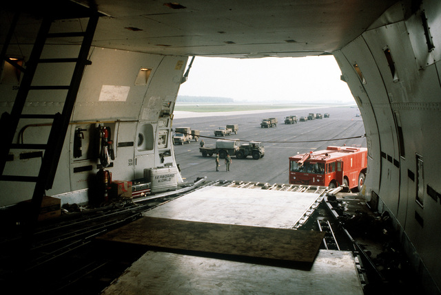 A view from the interior of a 747 cargo aircraft as equipment arrives to be loaded aboard during Operation Ocean Venture '82