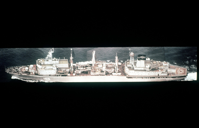 Aerial port beam view of a Soviet Berezina class fleet replenishment ship