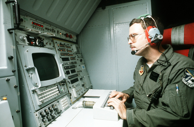 MSGT Thomas E. Valentas keys information into the main computer on board an E-3A Sentry aircraft during Operation Ocean Venture '82. The E-3A is equipped with the Airborne Warning and Control System (AWACS)