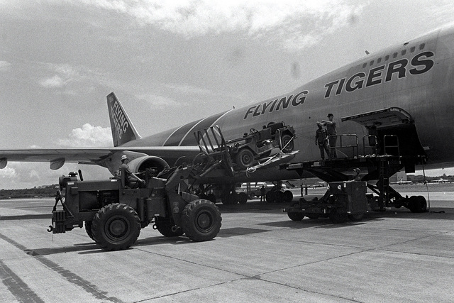 Marines load equipment aboard a Boeing 747 during Operation Ocean Venture '82