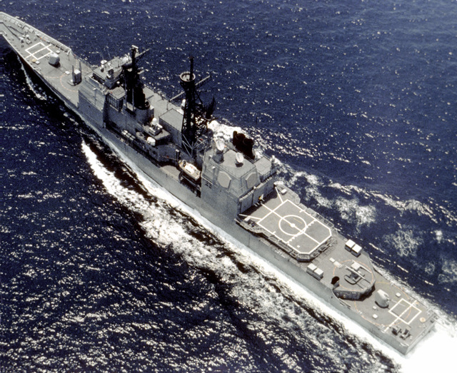 An aerial port quarter view of the Aegis guided missile cruiser TICONDEROGA (CG-47) underway during its first sea trials