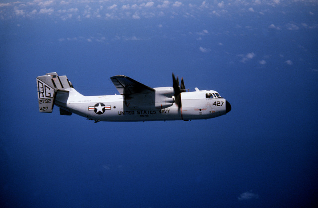 An air-to-air right side view of a C-2A Greyhound aircraft from Fleet Logistic Support Squadron 50 (VRC-50)