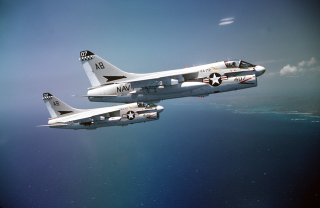 An air-to-air right side view of two A-7 Corsair aircraft assigned to Light Attack Squadron 72 (VA-72) on the aircraft carrier USS AMERICA (CV 66)