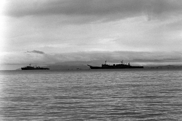 A dock landing ship and a tank landing ship, right, stand off shore as a beach assault is made as part of Operation Ocean Venture '82