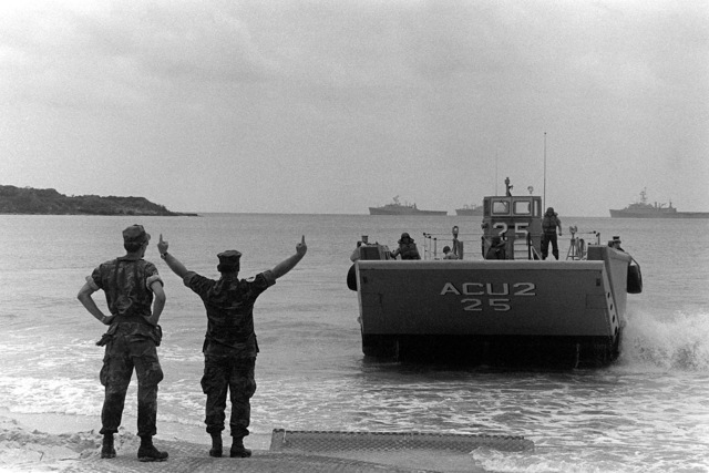 Marines from the Fourth Marine Amphibious Brigade direct an LCM-8 mechanized landing craft from the beach during Operation Ocean Venture '82