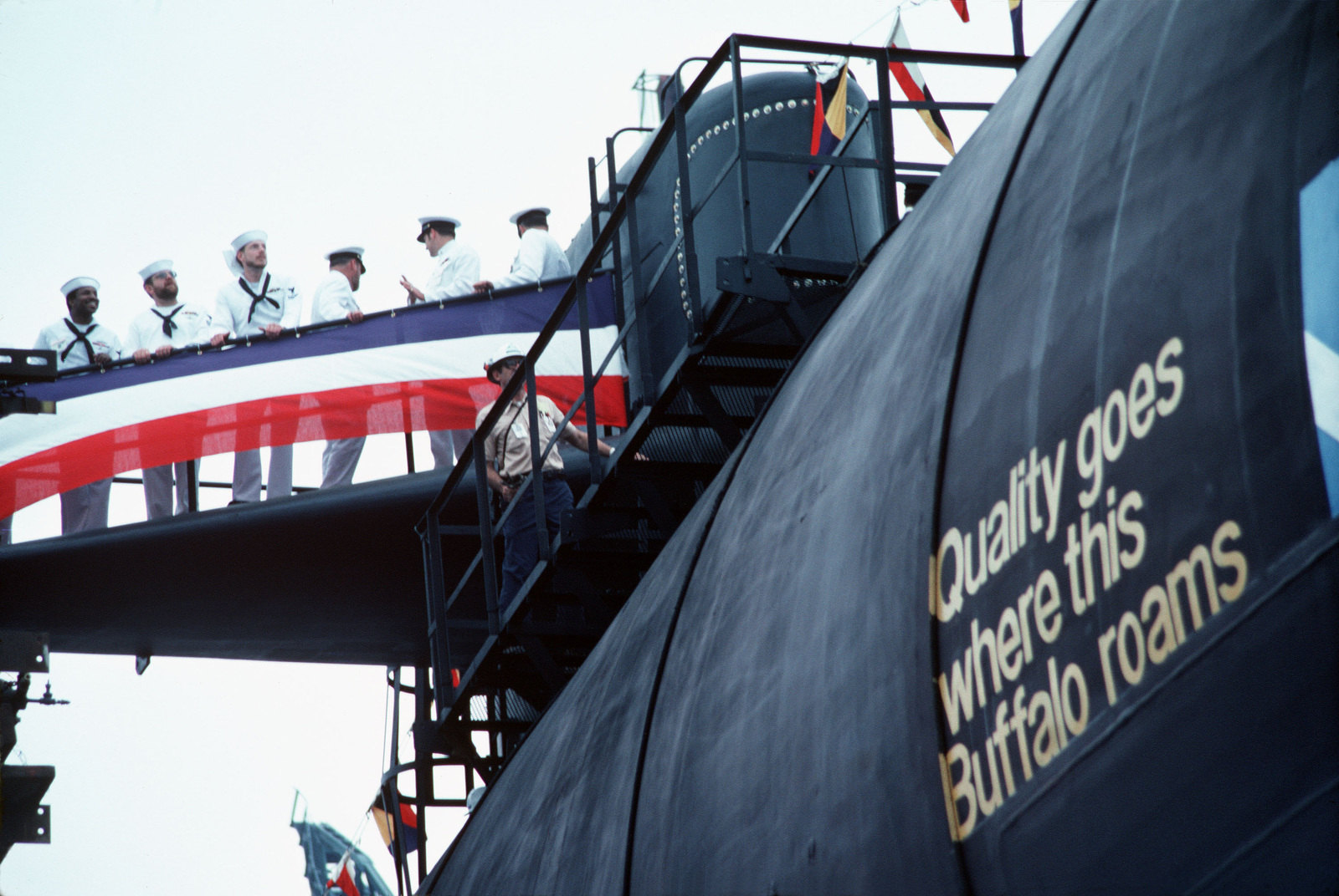 Crewmen stand on the sail of the nuclear-powered attack submarine USS BUFFALO (SSN-715) during the launching ceremony