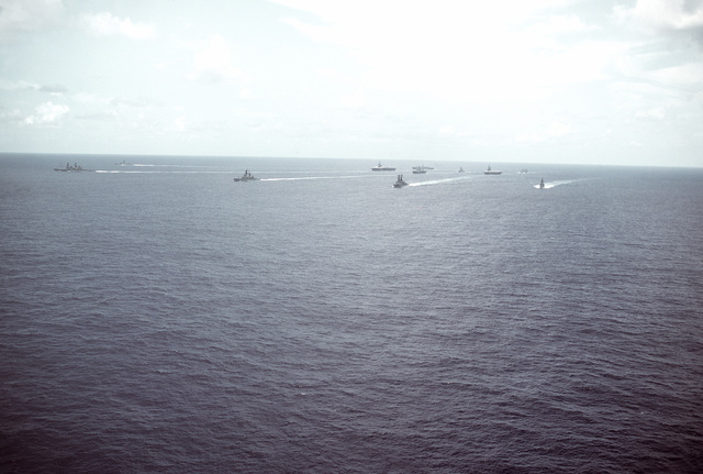 Aerial port bow view of part of Task Group 70, including the amphibious command ship USS BLUE RIDGE (LCC-19) and the aircraft carrier battle groups USS RANGER (CV-61) and MIDWAY (CV-41) underway