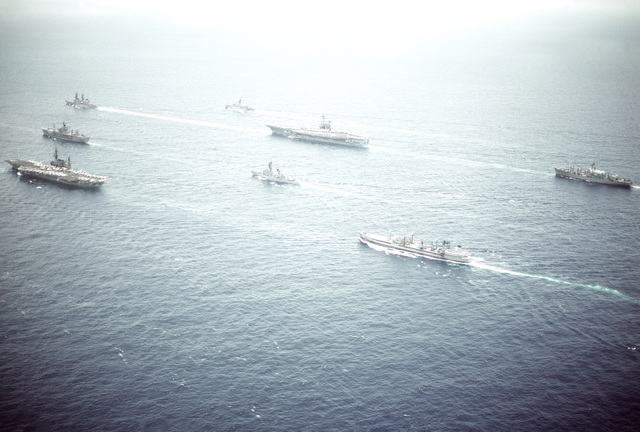 Aerial port view of part of Task Group 70, including the amphibious command ship USS BLUE RIDGE (LCC-19) and the aircraft carrier battle groups USS RANGER (CV-61) and MIDWAY (CV-41) underway