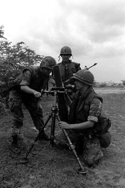 U.S. Marines set up a gun tripod on the beach during Operation Ocean Venture '82