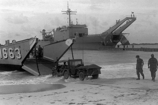 Equipment is offloaded from a utility landing craft (LCU-1663) and a Newport class tank landing ship during Operation Ocean Venture '82