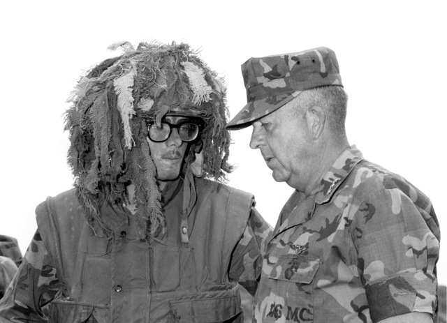 During LGEN John K. Davis' tour of Camp Pendleton, he talks to one of the sniper school students. Davis is the commanding general of the Fleet Marine Force, Pacific