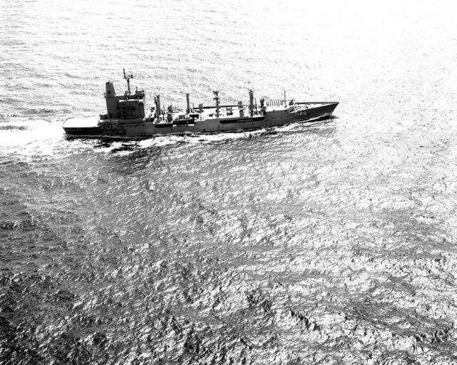 A starboard beam view of the fleet oiler USS WILLAMETTE (AO-180) underway