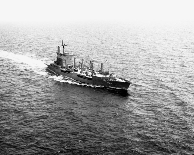 A starboard beam view of the fleet oiler USS WILLAMETTE (AO-180) underway