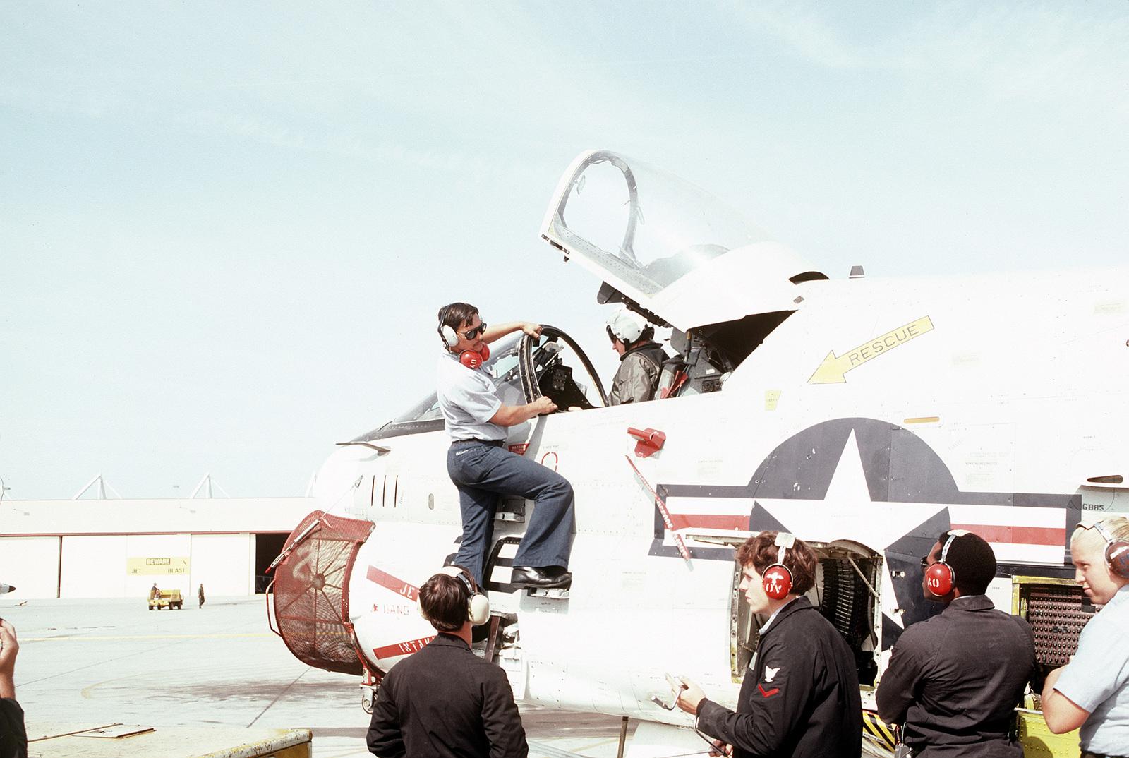 Crewmen from Light Attack Squadron 122 (VA-122) perform preflight maintenance on an A-7 Corsair II aircraft