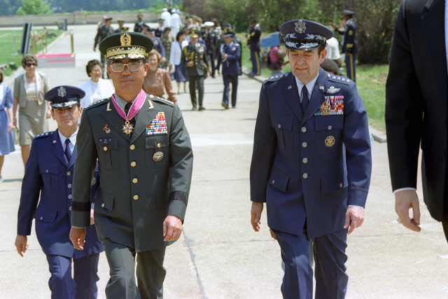U.S. Air Force GEN. David C. Jones (second from right), Chairman of the Joint Chiefs of STAFF and ceremony host, escorts Republic of Korea Army GEN. Yoon Sung Min (second from left, wearing the Legion of Merit, Degree of Commander), Chairman, Joint Chiefs of STAFF, Korean Armed Forces, as they walk up steps leading into the Pentagon after a Full Honors Arrival Ceremony for GEN. Yoon Sung Min, conducted outside the Pentagon on May 18, 1982.  OSD Package No. A07D-00362 (DOD PHOTO by Helene C. Stikkel) (Released)