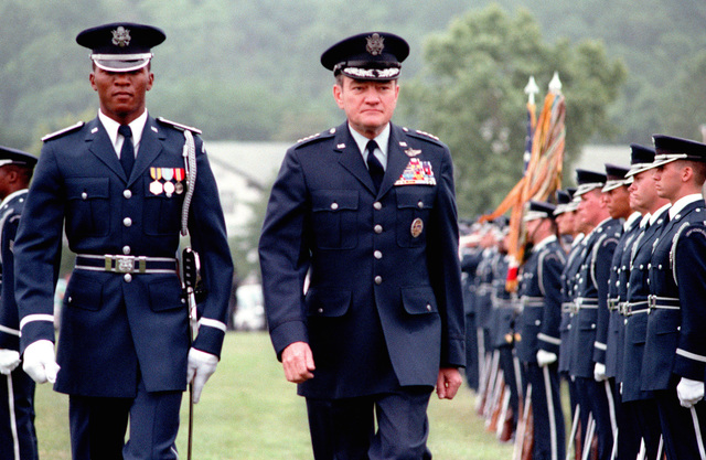 GEN Robert C. Mathis inspects the Air Force personnel participating in his retirement ceremony at Bolling Air Force Base