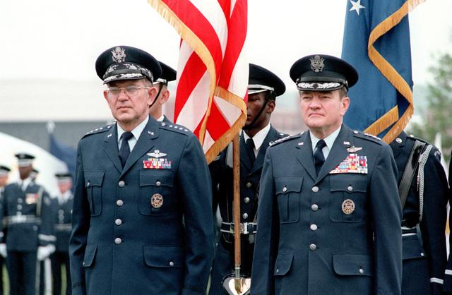 GEN Robert C. Mathis (right), stands during his retirement ceremony