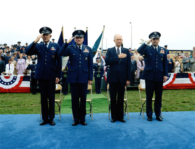 Left to right GEN Lew Allen, Air Force chief of staff, GEN Robert C. Mathis, Verne Orr, secretary of the Air Force, and GEN David C. Jones stand during the retirement ceremony for GEN Mathis