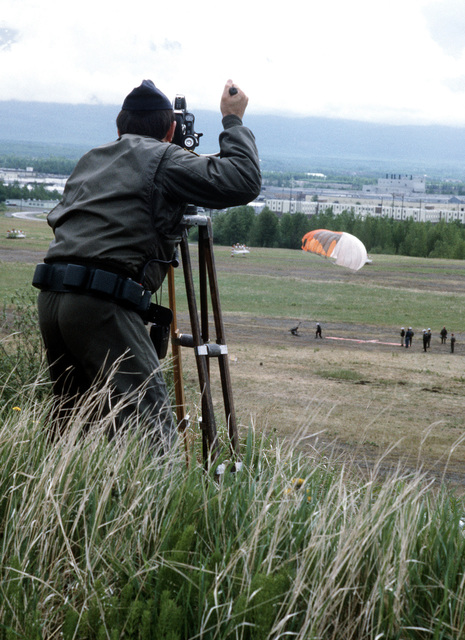 A cameraman films a Canadian search and rescue team member as he parachutes near his target during SAREX, a joint U.S. - Canadian exercise