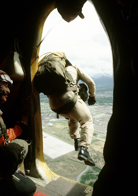 A Canadian search and rescue team member jumps from a DHC-5 Buffalo aircraft during SAREX, a joint U.S. - Canadian exercise taking place in Alaska