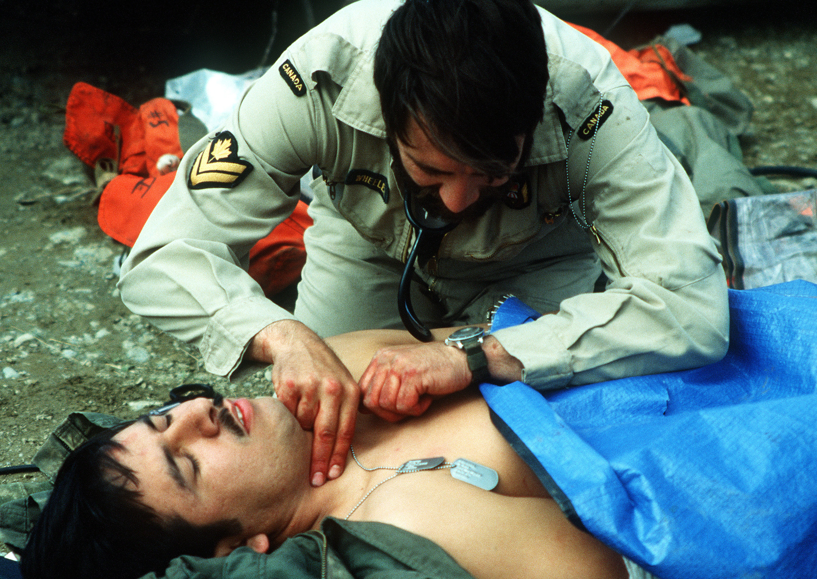 """A Canadian search and rescue team member takes a """"victim's"""" pulse during SAREX, a joint U.S. - Canadian exercise"""