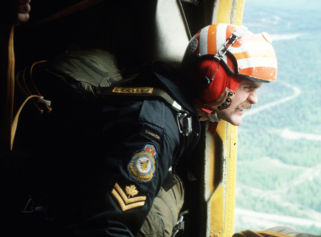 A Canadian search and rescue team members prepare for a jump from a DHC-5D Buffalo aircraft during SAREX, a joint U.S. - Canadian exercise taking place in Alaska