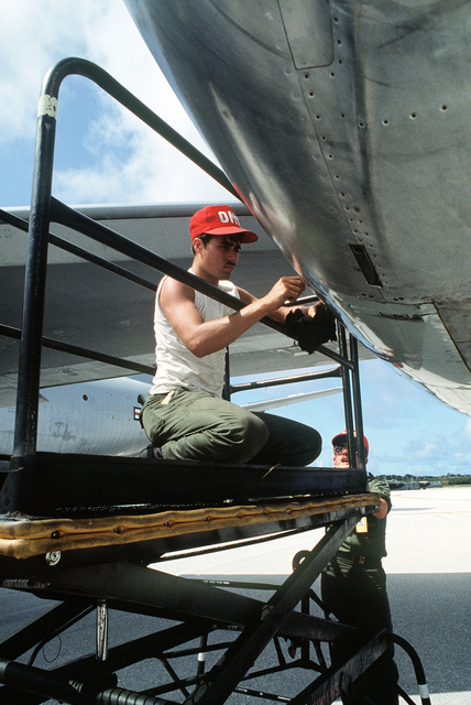 A ground crew member performs postflight maintenance on a KC-135 Stratotanker aircraft during Exercise Glad Customer '82