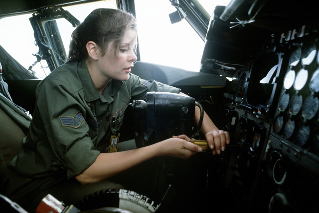 A ground crew member performs postflight maintenance on the instrument panel of a B-52H Stratofortress aircraft during Exercise Glad Customer '82