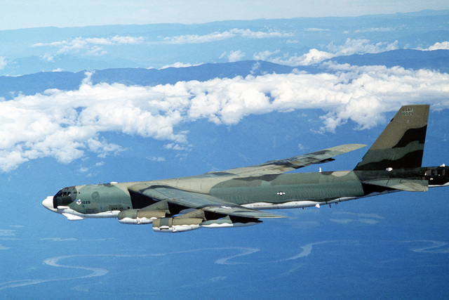 A left side view of a B-52H Stratofortress aircraft in flight from Guam to Darwin Royal Australian Air Force Base, Australia. The aircraft, assigned to the 37th Bomb Squadron, is participating in Exercise Glad Customer '82