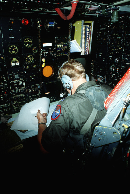 A navigator aboard a B-52H Stratofortress aircraft mans his position during a flight from Guam to Darwin Royal Australian Air Force Base, Australia. The navigator, assigned to the 37th Bomb Squadron, is a participant in Exercise Glad Customer '82