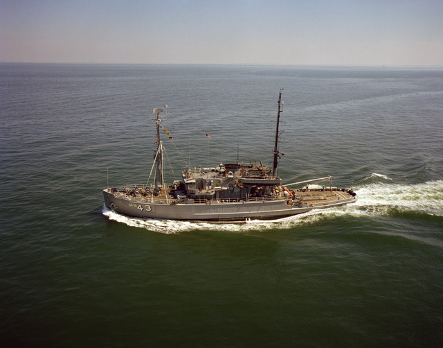 A port beam view of the salvage ship USS RECOVERY (ARS 43) underway