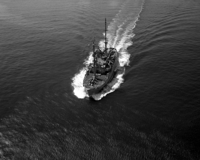 A port bow view of the salvage ship USS RECOVERY (ARS 43) underway