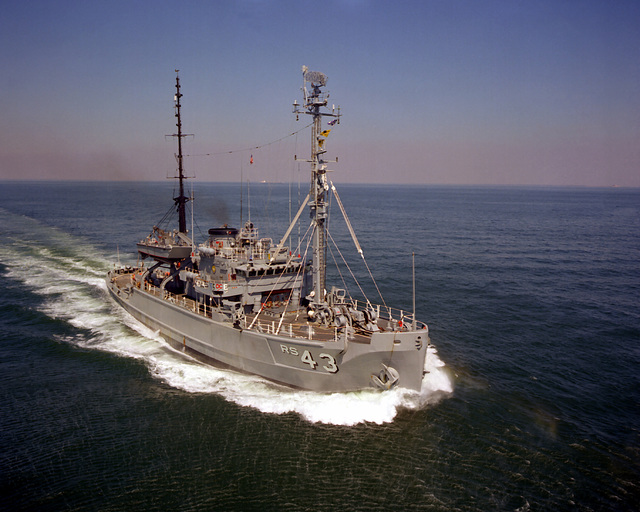 A starboard bow view of the salvage ship USS RECOVERY (ARS-43) underway