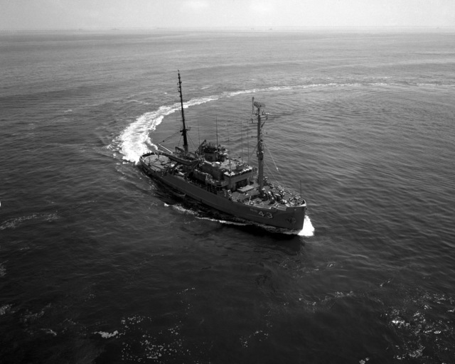 A starboard bow view of the salvage ship USS RECOVERY (ARS 43) underway