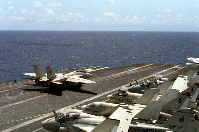 A view of AN F-14A Tomcat aircraft taking-off from the flight deck of the aircraft carrier USS AMERICA (CV-66). The F-14As are equipped with the Tactical Data Recording System (TDRS)