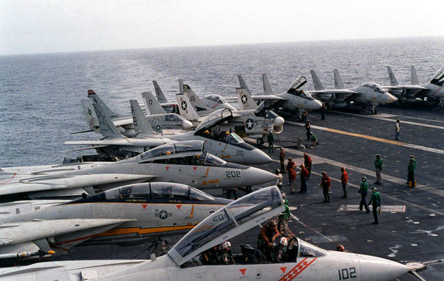A view of F-14A Tomcat aircraft from Fighter Squadrons 33 (VF-33) and 102 (VF-102) on the flight deck of the aircraft carrier USS AMERICA (CV-66). The F-14As are equipped with the Tactical Data Recording System (TDRS)