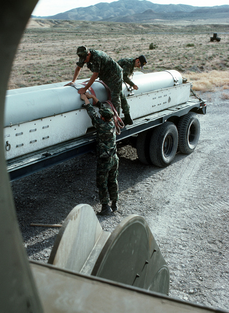 Air Force personnel secure an empty missile canister on a trailer truck at the Integrated Maintenance Facility. The Air Force is conducting a test and evaluation program for the ground-launched cruise missile's weapon system at the Integrated Maintenance Facility
