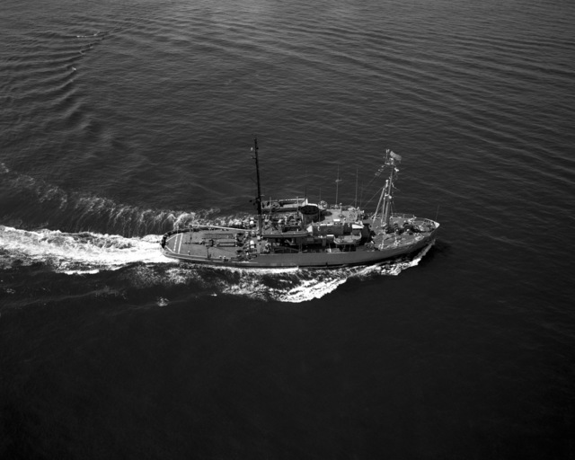 An aerial starboard beam view of the salvage ship USS RECOVERY (ARS 43) underway