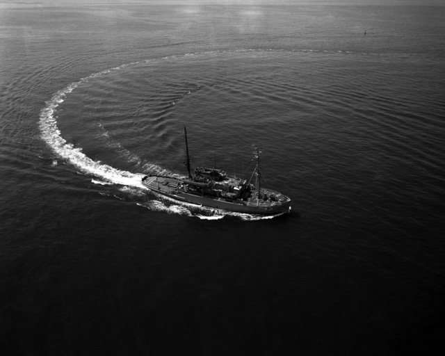 An aerial starboard bow view of the salvage ship USS RECOVERY (ARS 43) underway