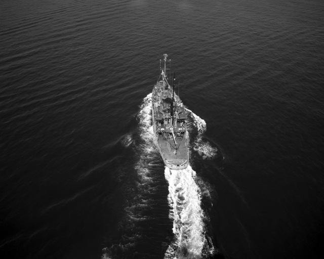 An aerial stern view of the salvage ship USS RECOVERY (ARS 43) underway