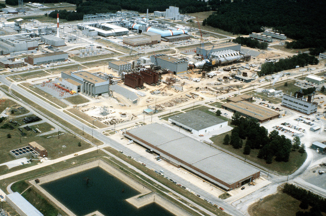 An aerial view (looking east) of the Aeropropulsion System Test Facility under construction at the Arnold Engineering Development Center (AEDC). The facility is designed to test future jet aircraft engine systems for the military services engine systems for the military services and other federal agencies. The AEDC is one of the world's largest jet propulsion testing facilities