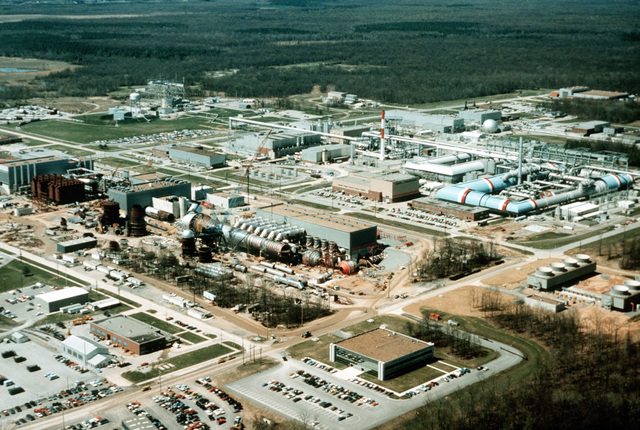 An aerial view (looking west) of the Aeropropulsion System Test Facility under construction at the Arnold Engineering Development Center (AEDC). The facility is designed to test future jet aircraft engine systems for the military services engine systems for the military services and other federal agencies. The AEDC is one of the world's largest jet propulsion testing facilities
