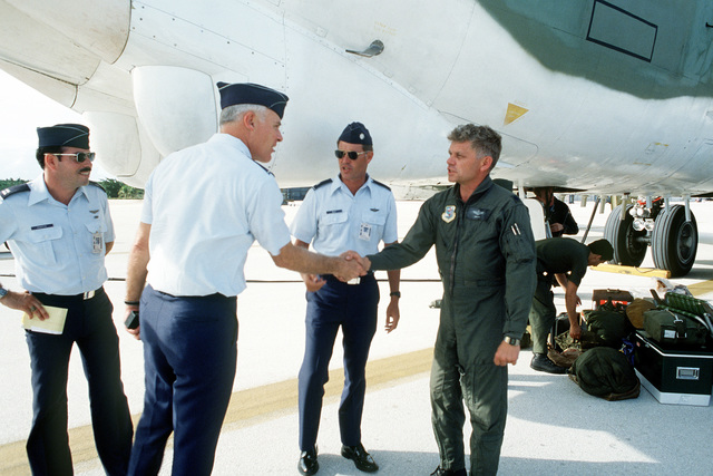 COL Meyers, commander of the 43rd Strategic Wing, greets LTC Kenneth J. Hacker, commander of the 37th Bomb Squadron. LTC Hacker arrived at the base aboard a B-52H Stratofortress aircraft to participate in Exercise Glad Customer '82
