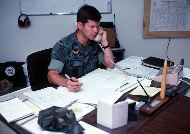 CPT Rick Sample, a ground-launcher cruise missile maintenance officer, making phone contact, is setting up a schedule for the Air Force test and evaluation program for the ground-launched cruise missile's Weapon system