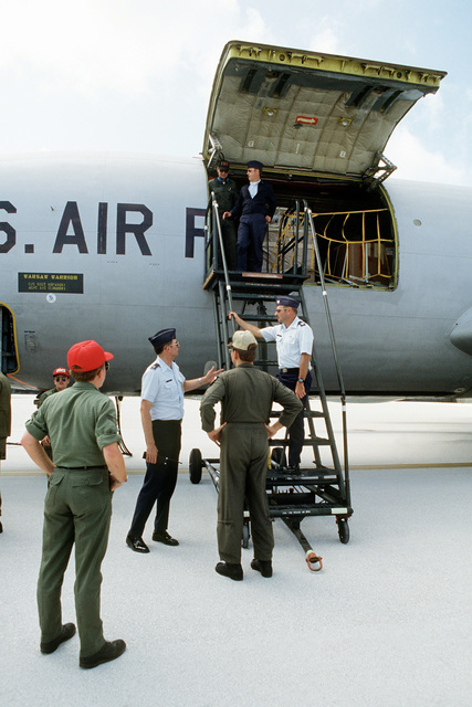 Ground crew members prepare to unload cargo, from a KC-135 Stratotanker aircraft. The aircraft, assigned to the 28th Bomb Wing is participating in Exercise Glad Customer '82