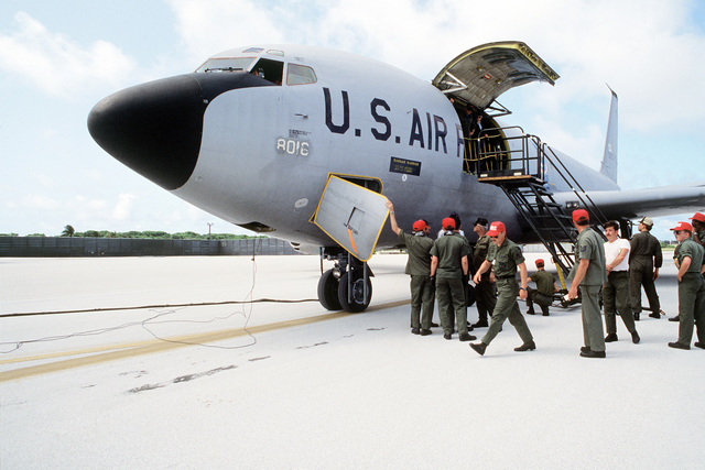 Ground crew members prepare to unload cargo from a KC-135 Stratotanker aircraft. The aircraft, assigned to the 28th bomb Wing, is participating in Exercise Glad Customer '82