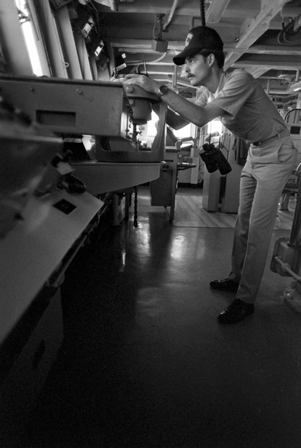 LT Ronald Clark operates the compass card repeater on the bridge of the Spruance class destroyer USS CUSHING (DD-985)
