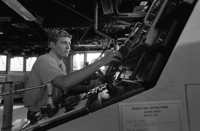 SEAMAN Roland Voshel scans the screen of the Digi-Plot on the bridge of the fleet oiler USS CIMARRON (AO 177)