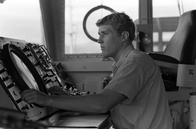Seman Roland Voshel scans the screen of the Digi-Plot on the bridge of the fleet oiler USS CIMARRON (AO 177)