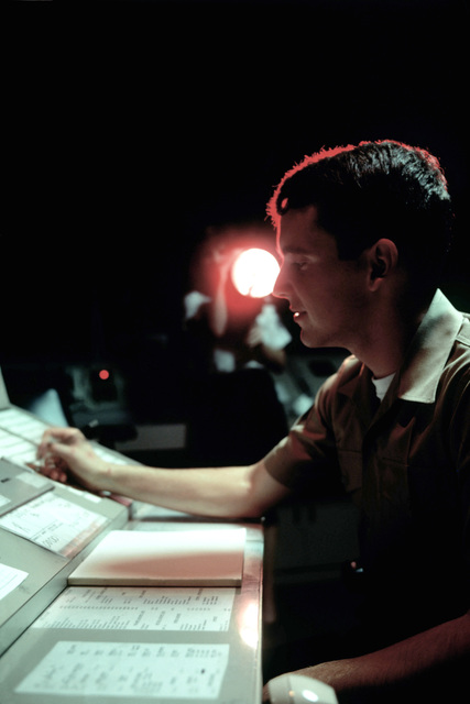 SGT Bob Miller works in the air traffic control tower at the Opa Locka Airport. Military personnel were moved into positions vacated by striking members of the Professional Air Traffic Controllers Organization